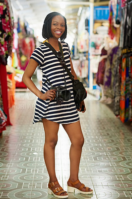 Buy stock photo Portrait of a young female tourist standing with her hand on her hip inside a grocery store