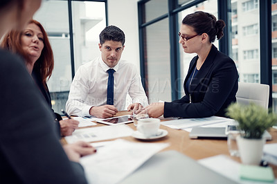 Buy stock photo Cropped of group of businesspeople having a meeting in an office