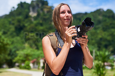 Buy stock photo Cropped shot of a young woman taking photographs outside