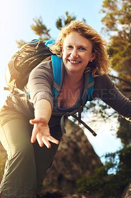 Buy stock photo Shot of a young woman out mountain climbing