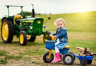 Buy stock photo Portrait of an adorable little girl carting stuffed animals in a toy truck around a farm