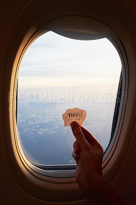 Buy stock photo Shot of an unrecognizable person's hand holding up a note against the window of a plane