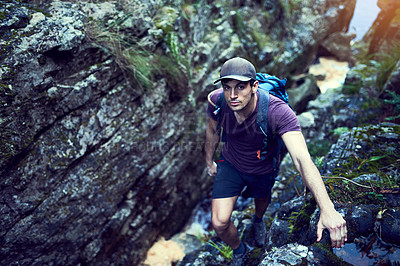 Buy stock photo Portrait of a young man exploring a hiking trail on his own
