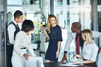 Buy stock photo Cropped shot of a group of businesspeople gathered in the boardroom for a meeting