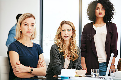 Buy stock photo Portrait of a group of young businesswomen having a meeting at work