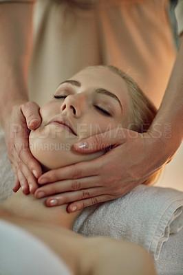 Buy stock photo Closeup shot of a young woman enjoying a massage at a spa