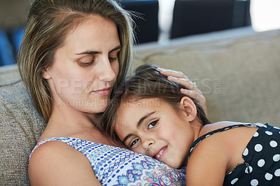 Buy stock photo Portrait of a little girl bonding with her mother at home
