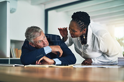 Buy stock photo Shot of a businesswoman waking her colleague as he sleeps at his desk