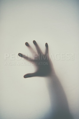Buy stock photo Defocussed shot of a single hand reaching out against a plain background