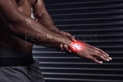 Buy stock photo Shot of an unrecognizable man rubbing his injured hand during a workout