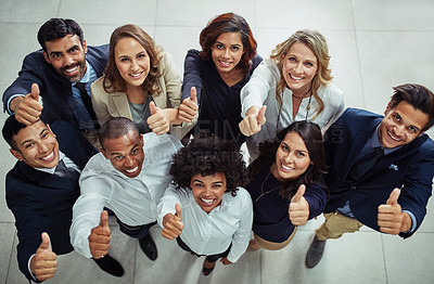 Buy stock photo Portrait of a diverse group of businesspeople showing thumbs up in an office