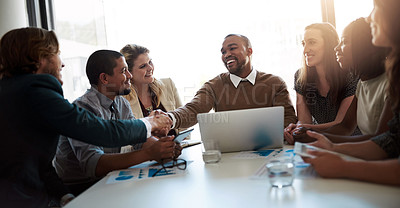 Buy stock photo Shot of a happy businessman welcoming a new employee to his team during a meeting