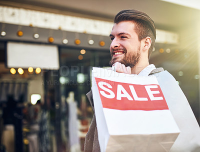 Buy stock photo Cropped shot of a young man holding a shopping bag