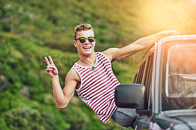 Buy stock photo Portrait of a young man leaning out the window of a car while on a roadtrip