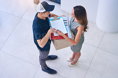 Buy stock photo Shot of a courier making a delivery to a businesswoman in an office