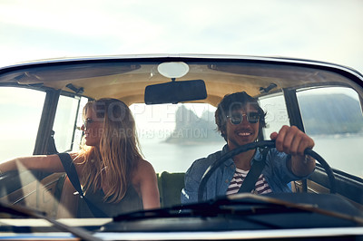 Buy stock photo Cropped shot of an affectionate young couple taking a roadtrip together