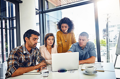 Buy stock photo Cropped shot of a team of designers having a meeting in an office