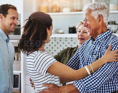 Buy stock photo Cropped shot of a couple visiting their parents at home