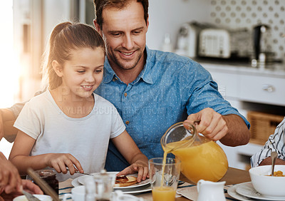 Buy stock photo Cropped shot of a father and his little daughter having breakfast together at home