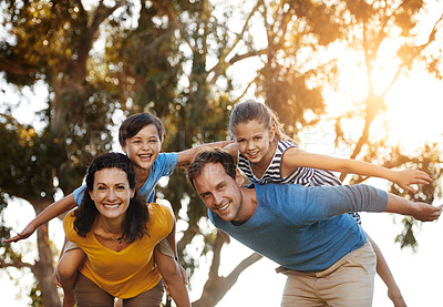 Buy stock photo Portrait of a family with two young children posing together outside