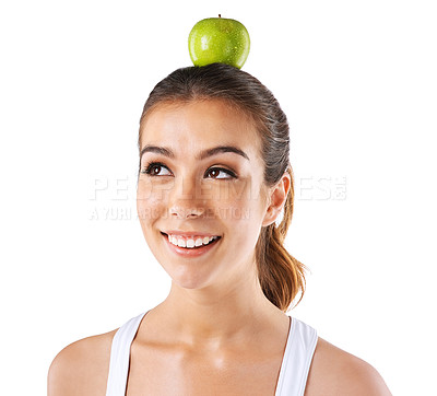 Buy stock photo Cropped shot of a woman posing with an apple on her head