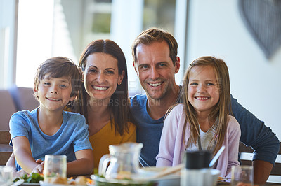 Buy stock photo Portrait of a family enjoying a meal together at home