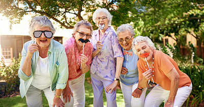 Buy stock photo Cropped portrait of a group of quirky senior friends messing around outdoors
