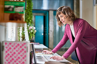 Buy stock photo Shot of an attractive young businesswoman working in her office