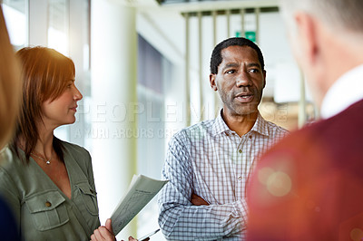 Buy stock photo Shot of a group of professional businesspeople talking in the office
