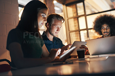 Buy stock photo Shot of a group of designers having a brainstorming session in the boardroom