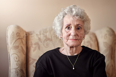 Buy stock photo Portrait of a senior woman sitting on a chair at home