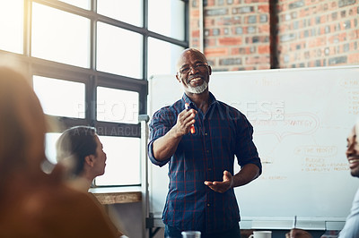 Buy stock photo Cropped portrait of a mature businessman giving a presentation in the boardroom