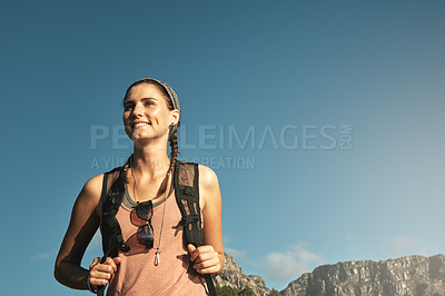 Buy stock photo Shot of a young woman out on a hike through the mountains