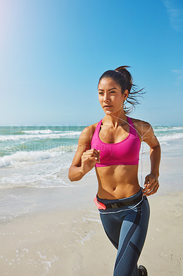 Buy stock photo Shot of an attractive young woman working out on the beach