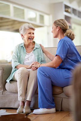 Buy stock photo Shot of a caregiver sitting with a senior patient in a nursing home