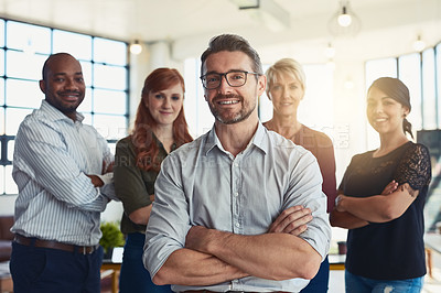Buy stock photo Portrait of a group of designers standing in an office