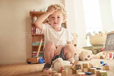 Buy stock photo Portrait of an adorable little boy playing with wooden blocks at home