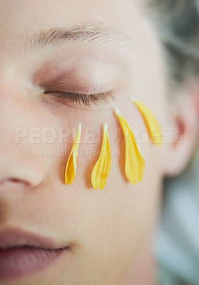 Buy stock photo Cropped shot of a young man's face with flower petals under his eye with his eyes closed