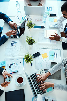 Buy stock photo High angle shot of unrecognisable businesspeople working in an office