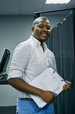 Buy stock photo Portrait of a confident IT technician working in a data center