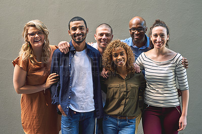Buy stock photo Shot of a group cheerful friends standing together for a portrait while looking at the camera