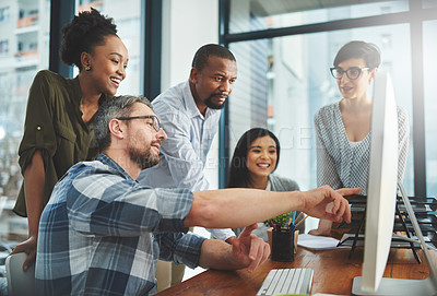 Buy stock photo Shot of businesspeople working together in the office