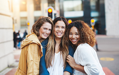 Buy stock photo Cropped shot of three friends having fun in the city
