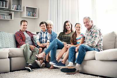Buy stock photo Shot of a three-generational family sitting together on a sofa at home