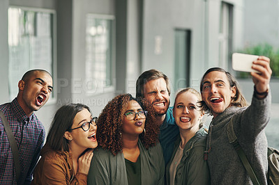 Buy stock photo Portrait of a group of happy young students taking a selfie together on campus