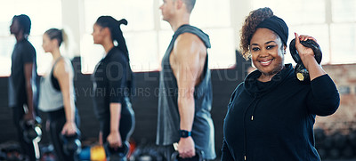 Buy stock photo Shot of a cheerful group of young people standing in a row and training with weights while one looks into the camera in a gym