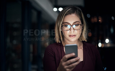 Buy stock photo Cropped shot of an attractive young businesswoman working late at the office