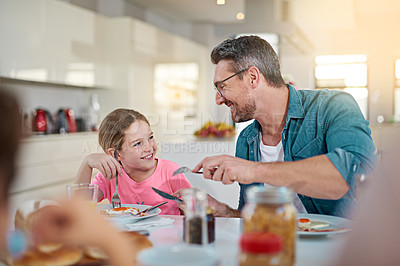 Buy stock photo Cropped shot of a handsome man having breakfast with his daughter at their dining room table