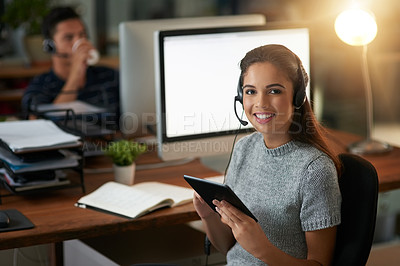Buy stock photo Shot of young agents working in a call center
