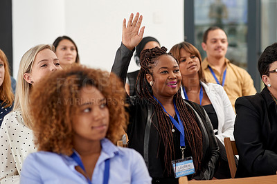 Buy stock photo Shot of a young woman raising her hand during a business conference